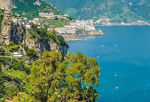 amalfi coast salerno lush coastal mountains with homes - CAPODANNO a CASERTA Costiera Amalfitana e le luci d'artista di Salerno – Napoli